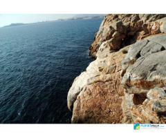 Isla Plana y cuevas del Agua